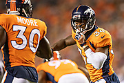 DENVER, CO - AUGUST 11:  Will Parks #34 and Jordan Moore #30 of the Denver Broncos talk on the field during a game against the Minnesota Vikings during week one of the preseason at Broncos Stadium at Mile High on August 11, 2018 in Denver, Colorado.  The Vikings defeated the Broncos 42-28.  (Photo by Wesley Hitt/Getty Images) *** Local Caption *** Will Parks; Jordan Moore