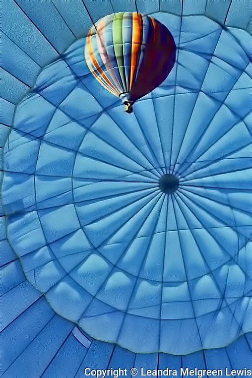 Composite photo of hot air ballon flying with crown of the ballon as the background.
