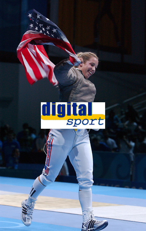 Mariel Zagunis (USA) celebrates winning the Womens Sabre Gold Medal, Fencing, Athens Olympics, 17/08/2004. Credit: Colorsport / Matthew Impey DIGITAL FILE ONLY