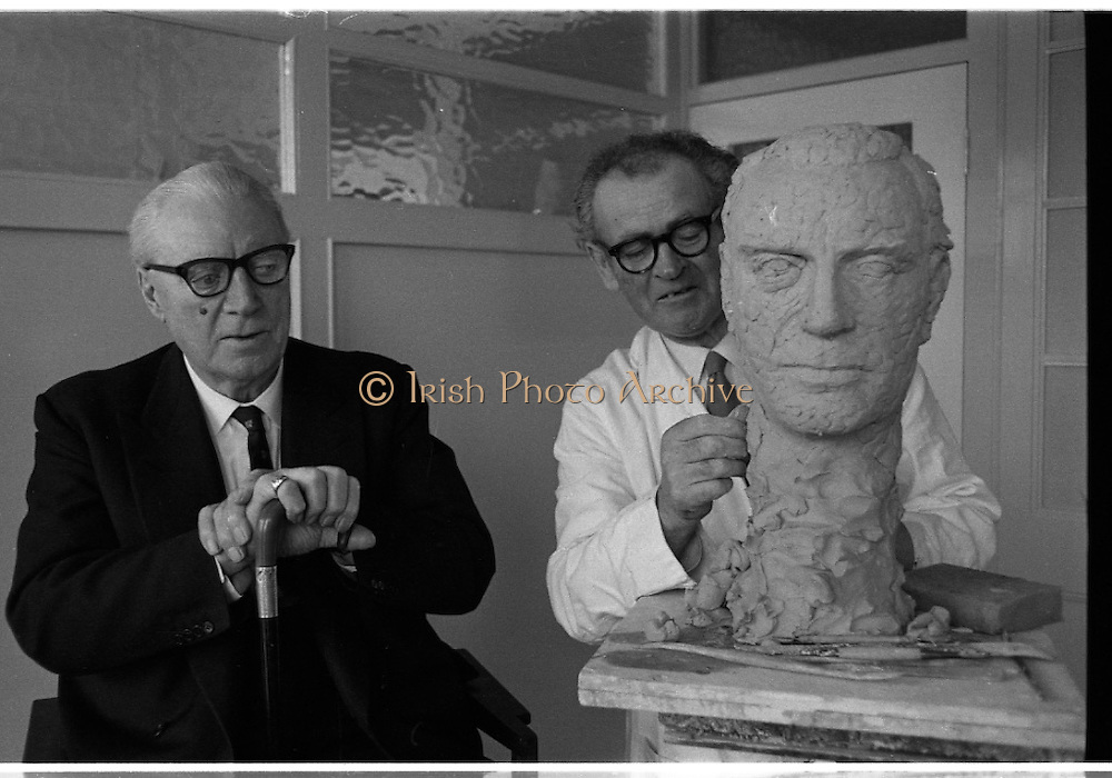 Sculptor Seamus Murphy at work. Murphy has been commissioned by the staff of the New Ireland Assurance Company to make a bronze bust of Dr. M.W. O'Reilly, Chairman and Managing Director of the company. The bust will be presented to Dr. O'Reilly to mark the Golden Jubilee of the New Ireland Assurance Company. Picture shows Dr. O'Reilly sitting for Seamus Murphy at the company offices on Dawson Street.<br /> 31.01.1968