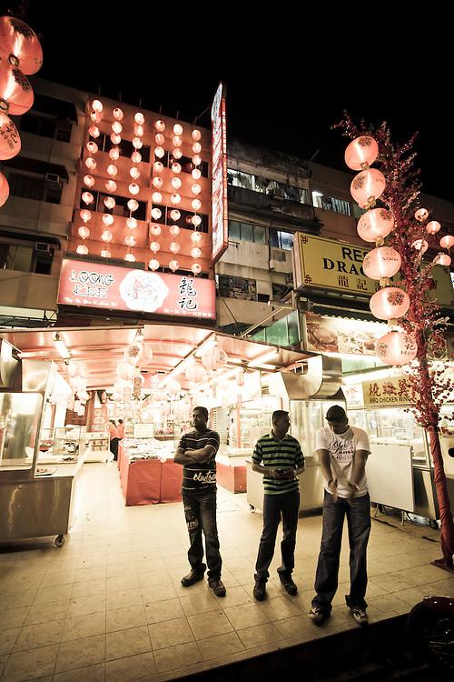 Men enjoying the outdoor food market in Bukit Binthang, Kuala Lumpur