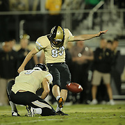 UCF Knights kicker Shawn Moffitt (83) kicks a field goal during an NCAA football game between the South Florida Bulls and the 17th ranked University of Central Florida Knights at Bright House Networks Stadium on Friday, November 29, 2013 in Orlando, Florida. (AP Photo/Alex Menendez)