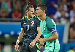 LYON, FRANCE - Wednesday, July 6, 2016: Wales' Gareth Bale and Portugal's captain Cristiano Ronaldo during the UEFA Euro 2016 Championship Semi-Final match at the Stade de Lyon. (Pic by David Rawcliffe/Propaganda)