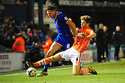 Mike Jones of Oldham Athletic is tackled by Luke Higham of Blackpool FC during the Sky Bet League 1 match between Oldham Athletic and Blackpool at SportsDirect.Com Park, Oldham, England on 15 March 2016. Photo by Mike Sheridan.