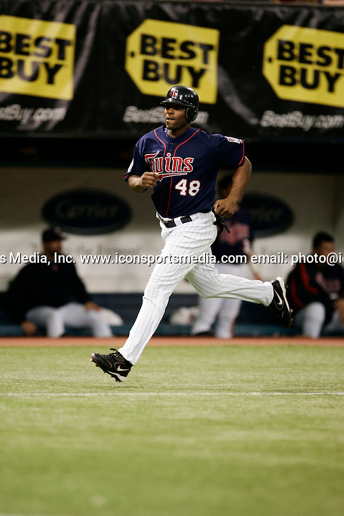 5 June 2005: Torri Hunter #48 of the Minnesota Twins scores a on a double by teammate Mathew LeCroy during the sixth inning of their game against the New York Yankees on June 5, 2005 at Metrodome in Minneapolis, Minnesota.  The Twins defeated the Yankees 9-3.