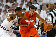 FAYETTEVILLE, AR - NOVEMBER 30:  Michael Carter-Williams #1 of the Syracuse Orangemen is guarded by DeQuavious Wagner #23 of the Arkansas Razorbacks at Bud Walton Arena on November 30, 2012 in Fayetteville, Arkansas.  The Orangemen defeated the Razorbacks 91-82.  (Photo by Wesley Hitt/Getty Images) *** Local Caption *** Michael Carter-Williams; DeQuavious Wagner
