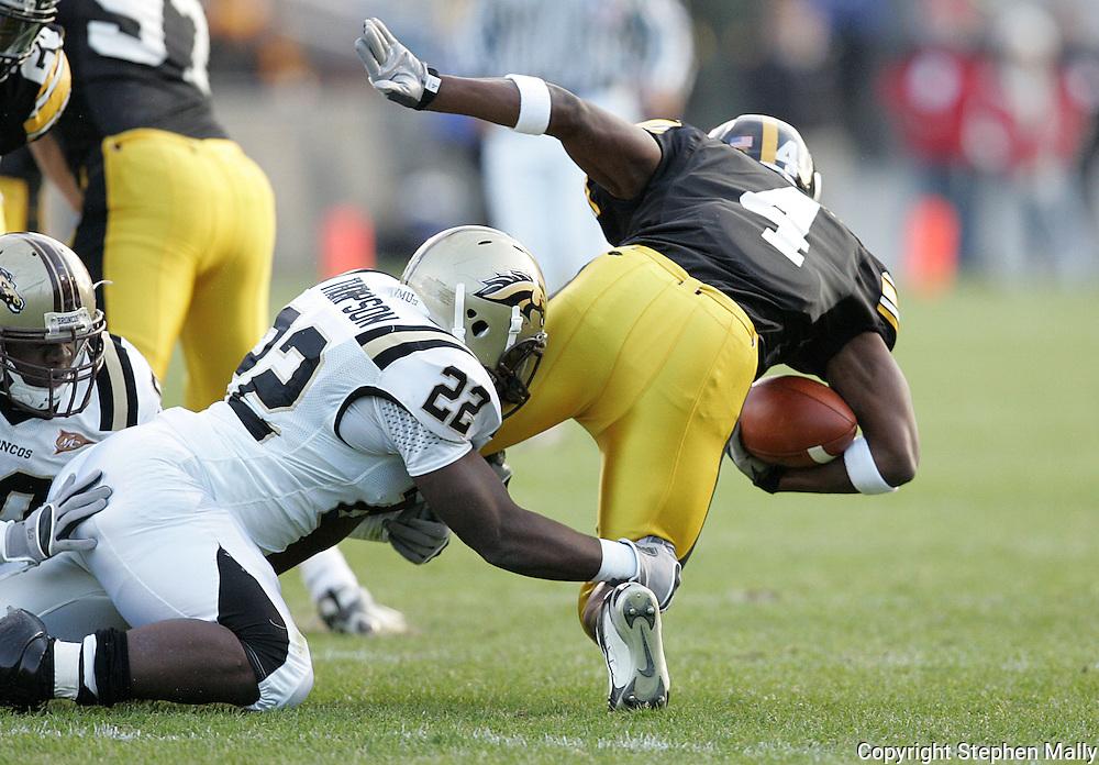 17 NOVEMBER 2007: Iowa's Jordan Bernstine (4) is brought down by Western Michigan's Glenis Thompson (22) in Western Michigan's 28-19 win over Iowa at Kinnick Stadium in Iowa City, Iowa on November 17, 2007.
