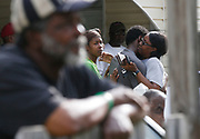 A man was shot to death in the front yard of a house 3120 20th Street in Tuscaloosa, May 1, 2019. Residents of the neighborhood gathered at homes along 20th Street to mourn the shooting death. [Staff Photo/Gary Cosby Jr.]