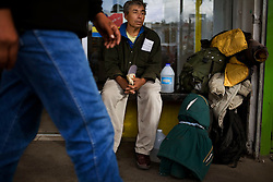 An immigrant sits in the streets of Nogales with all his belongings. He was recently detained by US border patrol and returned to Mexico. He is now deciding whether he should go home or attempt to cross again.