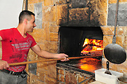 Israel, Mount Carmel, Isfiya (also known as Ussefiya, a Druze village and local council) A Druze Baker baking Pita