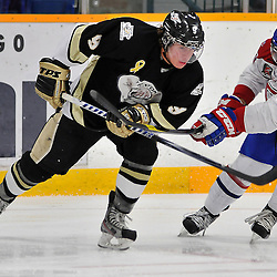 COBOURG, ON - Oct 19: Ontario Junior Hockey League game between Kingston Voyageurs and Trenton Golden Hawks. Jordan Minello #9 of the Trenton Golden Hawks battles for the puck with David Quesnele #20 of the Kingston Voyageurs during first period game action..(Photo by Shawn Muir / OJHL Images)
