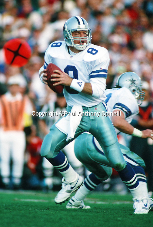 Dallas Cowboys quarterback Troy Aikman (8) drops back to pass during the NFL Super Bowl XXVII football game against the Buffalo Bills on Jan. 31, 1993 in Pasadena, Calif. The Cowboys won the game 52-17. (©Paul Anthony Spinelli)