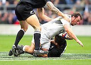 © SPORTZPICS /  Seconds Left Images 2010 - England's Steve Thompson is tackled by New Zealand's Danl Carter -  England v New Zealand All Blacks - Investec Challenge Series - 06/11/2010 - Twickenham Stadium  - London - All rights reserved..