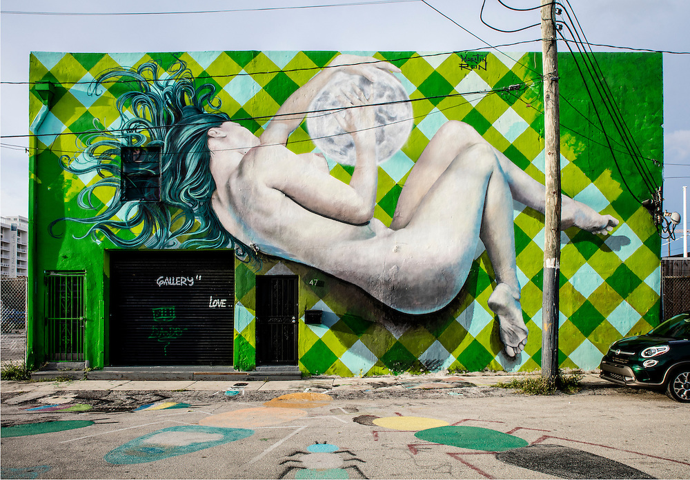 A painted nude covers amost all of a two-story building in Miami'a Wynwood arts district