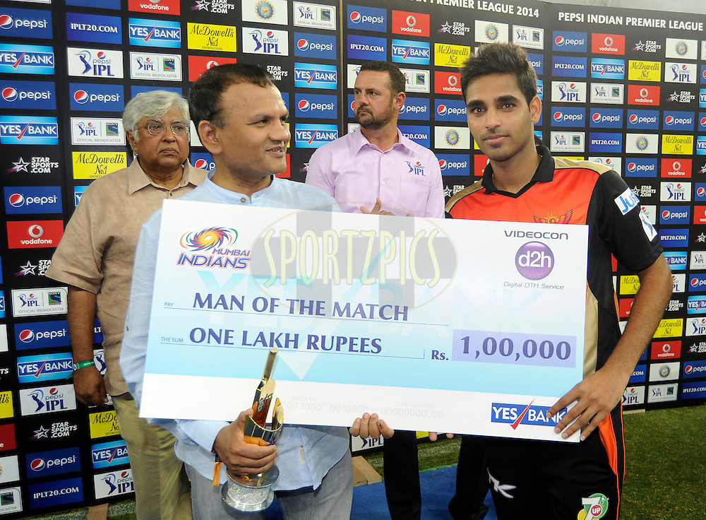 Bhuvneshwar Kumar of the Sunrisers Hyderabad receives the man of the match award during the presentation after match 20 of the Pepsi Indian Premier League Season 2014 between the Mumbai Indians and the Sunrisers Hyderabad held at the Dubai International Stadium, Dubai, United Arab Emirates on the 30th April 2014<br /> <br /> Photo by Pal Pillia / IPL / SPORTZPICS