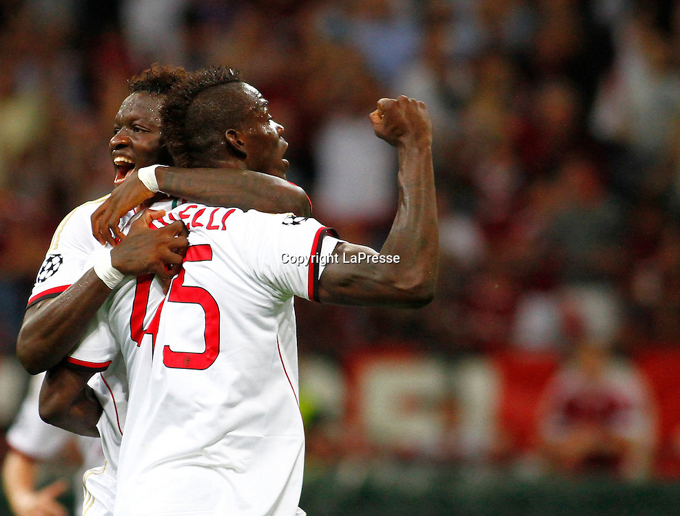 Foto Spada - LaPresse<br /> 28 08 2013 Milano, Italia<br /> UEFA Champions League 2013/2014 - Milan vs. PSV Eindhoven  <br /> Nella foto:  Balotelli esultanza gol 2-0 , Muntari <br /> <br /> Photo Spada - LaPresse<br /> 28 08 2013 Milan, Italy<br /> UEFA Champions League 2013/2014 - Milan vs. PSV Eindhoven <br /> In the pic: Balotelli celebrates after scoring goal 2-0, Muntari