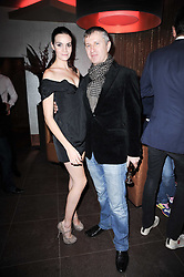 FRED MOSS and his wife FEARNE at a birthday party for Laurie Bilton held at Maddox Club, 2 Mill Street, London on 5th February 2010.
