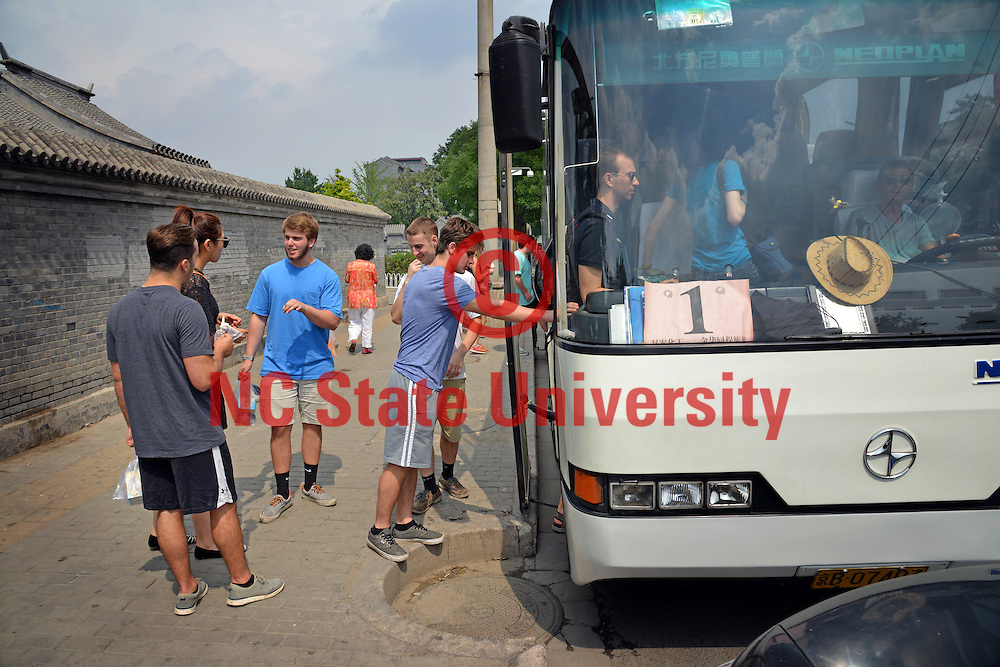 Poole College of Management students load their bus in Beijing.