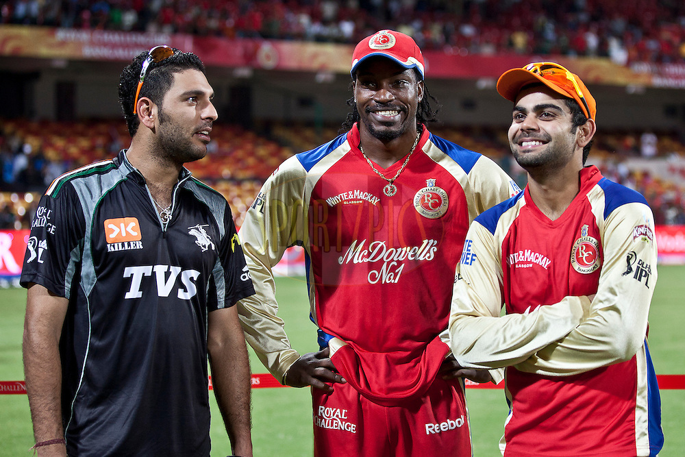 PW captain Yuvraj Sing(L), RCB player Chris  Gayl(C) and RCB player Virat Koholi during match 35 of the the Indian Premier League ( IPL ) Season 4 between the Royal Challengers Bangalore and the Pune Warriors held at the Chinnaswamy Stadium, Bangalore, Karnataka, India on the 29th April 2011..Photo by Saikat Das/BCCI/SPORTZPICS