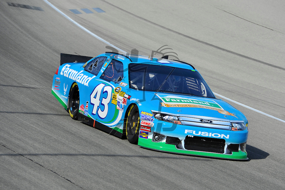 Joliet, IL - SEP 14, 2012: Aric Almirola (43) in turn 4 during practice for the Geico 400 at the Chicagoland Speedway in Joliet, IL.