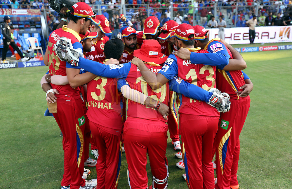 Royal Challengers Bangalore players huddle after the first innings of the match 46 of the Pepsi IPL 2015 (Indian Premier League) between The Mumbai Indians and The Royal Challengers Bangalore held at the Wankhede Stadium in Mumbai, India on the 10th May 2015.<br /> <br /> Photo by:  Sandeep Shetty / SPORTZPICS / IPL