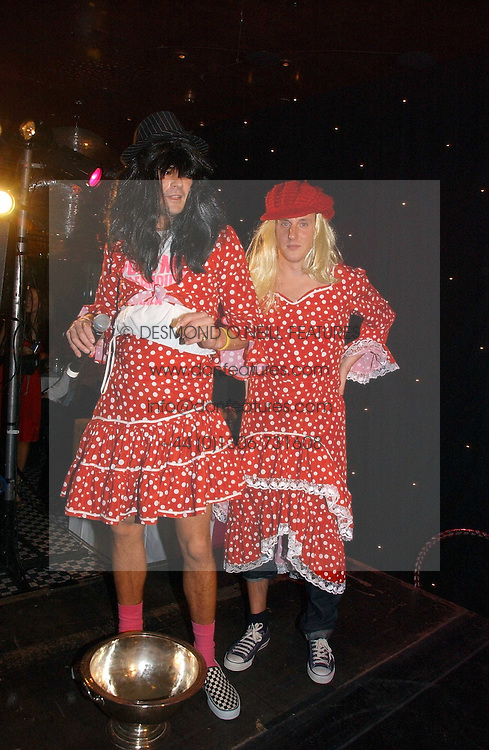 Left to right, EDWARD TAYLOR and HARRY BECHER at The Christmas Cracker - an evening i aid of the Starlight Children's Charity held at Frankies, Knightsbridge on 13th December 2006.<br />