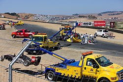 Clean up crews pick up the pieces after a multi car crash in the Jim Russell Racing Drivers School Exhibition Race prior to the start of the 2009 Sonoma Grand Prix IndyCar race was held at Infineon Raceway in Sonoma, California on August 23, 2009.