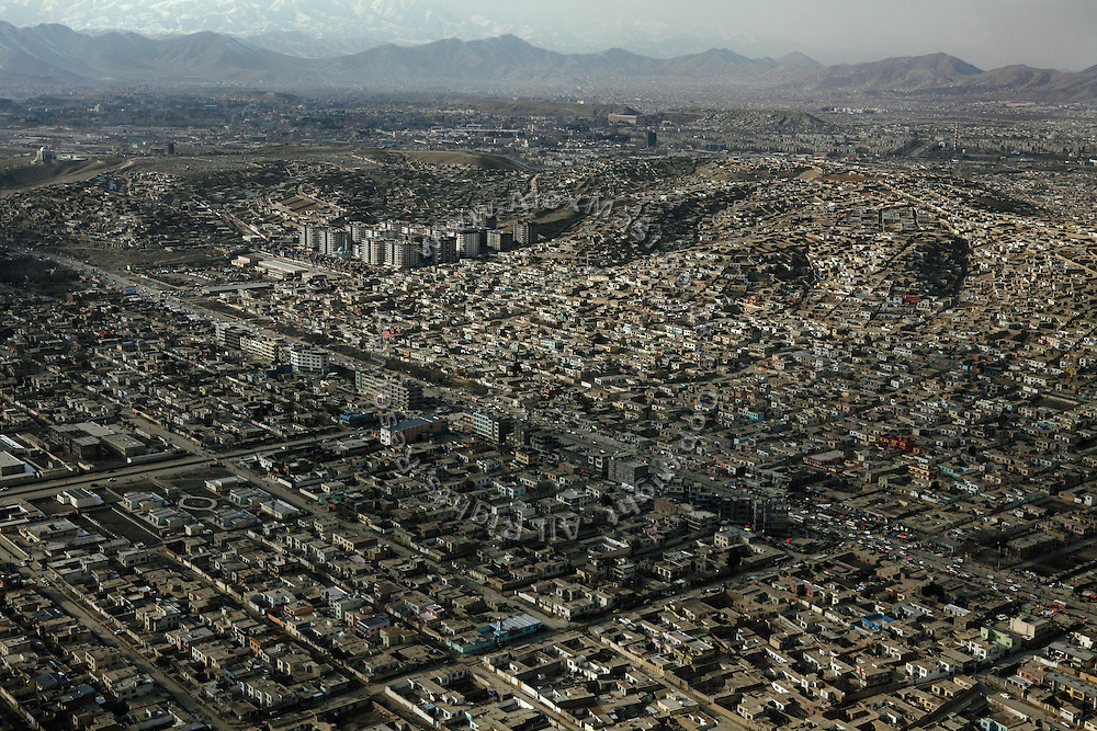 A section of Kabul, Afghanistan, is photographed from a helicopter flying over the city.