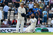 Sam Curran of England and Moeen Ali of England during the drinks break during the first day of the 4th SpecSavers International Test Match 2018 match between England and India at the Ageas Bowl, Southampton, United Kingdom on 30 August 2018.