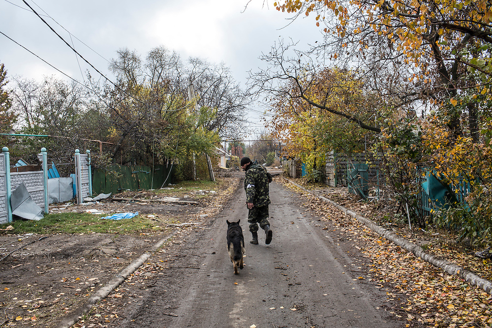 A pro-Russian rebel fighter in the Kievsky district where they coordinate fighting to gain control of the Donetsk airport on Friday, October 17, 2014 in Donetsk, Ukraine. Photo by Brendan Hoffman, Freelance