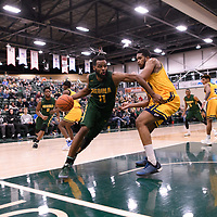 5th year forward Brian Ofori (11) of the Regina Cougars in action during the Men's Basketball home game on January  20 at Centre for Kinesiology, Health and Sport. Credit: /Arthur Images
