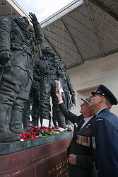 © licensed to London News Pictures. London, UK 30/06/2012. An Australian veteran and an Australian Army officer visiting Bomber Command Memorial in Green Park in the name of 55,573 Bomber Command airmen who gave their lives in the Second World. The memorial was opened by the Queen earlier this week. Photo credit: Tolga Akmen/LNP