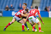 Hamish Watson (#7) of Edinburgh Rugby is tackled by Raphael Lagarde (#10) and Jamie-Jerry Taulagi (#14) of SU Agen Rugby during the European Rugby Challenge Cup match between Edinburgh Rugby and SU Agen at BT Murrayfield, Edinburgh, Scotland on 18 January 2020.