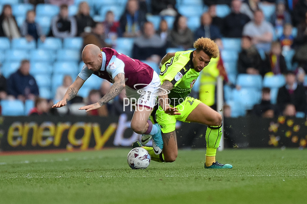 Aston Villa defender Alan Hutton (21) battles for possession with Reading midfielder Danny Williams (23) during the EFL Sky Bet Championship match between Aston Villa and Reading at Villa Park, Birmingham, England on 15 April 2017. Photo by Dennis Goodwin.