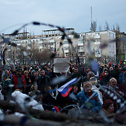 Pro-Russia activists attend a rally at the grounds of Donbass Regional Government building in central Donetsk. Activists occupied the building over the past weekend and are now barricaded inside expecting a policial intervention as the Ukrainian government in Kiev gave a 48 hour deadline for the activists to abandon the building.