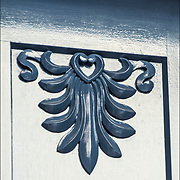 Akroter design elements on front door in Greenwick Village<br /> <br /> The Acroterion, also the Akroter or Akroterie design going around column.<br /> <br /> The Acroterion was in the Renaissance, the classicism and historical in the use element of ornamentation in architecture.<br /> <br /> The Acroterion, also the Akroter or Akroterie is used as an architectural element of the crowning of the gabled ridge and the ornament of the expiring pitched roof on the gable corners