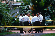 Police detectives investigate a lead in the murder of fashion designer Gianni Versace July 19, 1997 in Miami, FL.  Versace was murdered outside his Miami Beach home at the age of 50 by spree killer Andrew Cunanan.