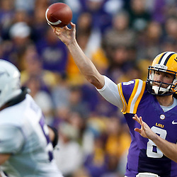 Oct 26, 2013; Baton Rouge, LA, USA; LSU Tigers quarterback Zach Mettenberger (8) throws against the Furman Paladins during the first quarter of a game at Tiger Stadium. Mandatory Credit: Derick E. Hingle-USA TODAY Sports