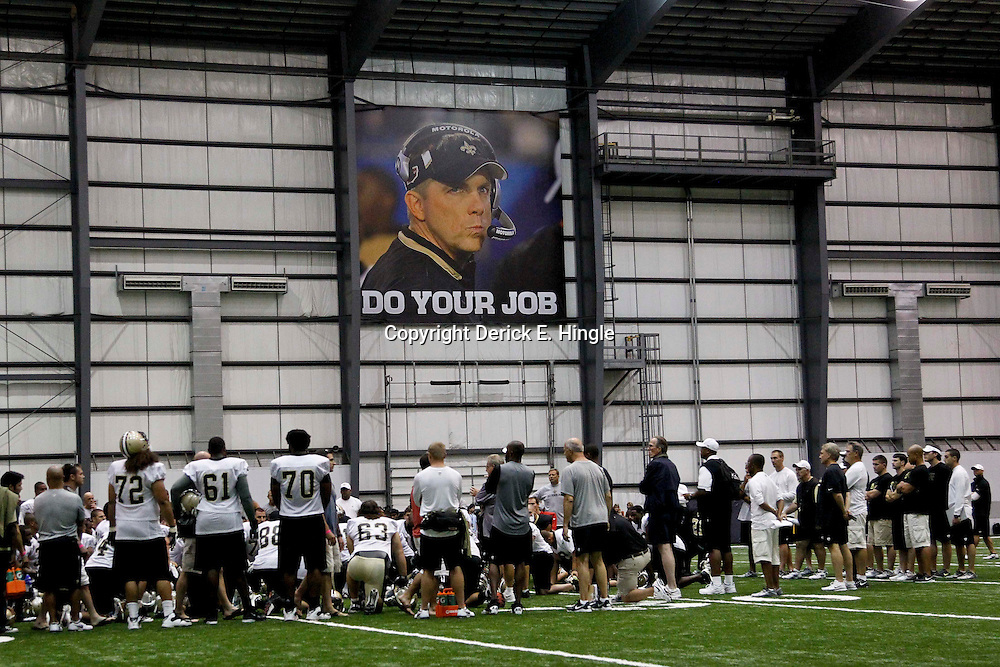 July 27, 2012; Metairie, LA, USA; A sign of suspended New Orleans Saints head coach Sean Payton is seen as players huddle on the field following training camp practice at the team's indoor practice facility. Mandatory Credit: Derick E. Hingle-US PRESSWIRE