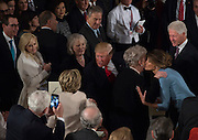 U.S. President Donald Trump greets Hillary Clinton in Statuary Hall in the U.S. Capitol for the Inaugural Luncheon following Donald Trump's inauguration as the 45th President of the United States, in Washington, DC, on January 20, 2017.
