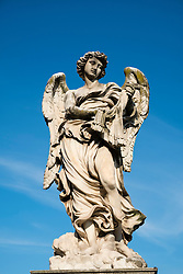 Statue on the  Ponte Vittorio Emanuele II bridge crossing the Tiber River near the Vatican City in Rome , Italy