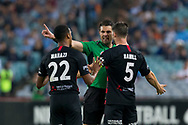 SYDNEY, AUSTRALIA - APRIL 13: Western Sydney Wanderers defender Brendan Hamill (5) and Western Sydney Wanderers midfielder Rashid Mahazi (22) argue with match referee Shaun Evans at round 25 of the Hyundai A-League Soccer between Western Sydney Wanderers and Sydney FC  on April 13, 2019 at ANZ Stadium in Sydney, Australia. (Photo by Speed Media/Icon Sportswire)
