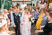 18 May 2018: Pupils from Pilgrim Academy in North East Lincs, took part in their own Royal Wedding this afternoon which was conducted by Rev Julie Donn, Parish Priest at Immingham St Andrew&rsquo;s Church. <br /> Victoria Parashkeveva (5) and Jacob Clark (5) played the roles of Prince Harry and Meghan Markle.<br /> They exchanged rings made from Haribo sweets.<br /> The primary school is part of the Tollbar Multi Academy Trust. <br /> Picture: Sean Spencer/Hull News &amp; Pictures Ltd<br /> 01482 210267/07976 433960<br /> www.hullnews.co.uk         sean@hullnews.co.uk