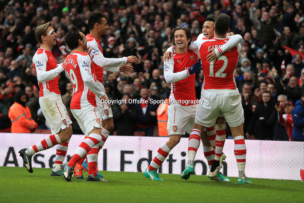 11 January 2015 - Barclays Premier League - Arsenal v Stoke City - Alexis Sanchez of Arsenal celebrates scoring from a free kick with team mates - Photo: Marc Atkins / Offside.