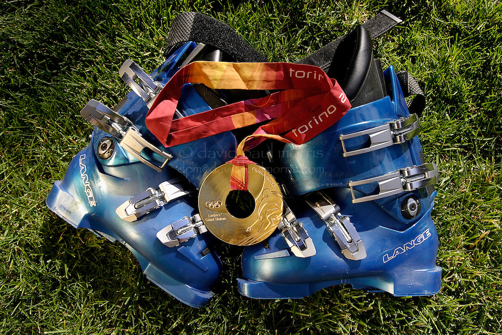 SQUAW VALLEY,  CA -  JULY 21:  The lucky Lange ski boots and gold medal of 2006 Olympic Gold Medal winner in the Womans Giant Slalom, Julia Mancuso, 22 on July 21, 2006 in Squaw Valley  California. (Photo by David Paul Morris/ for the Chronicle)