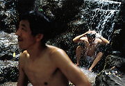 France, Paris, 06-2003..Illegal Chinese Mr Wang, 42, bathes in a park in Paris to beat the summer heat wave. He is part of a new wave of immigrants from China?s northeast, home to millions of former cradle-to-grave factory workers laid off by closures. ..