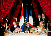 Staatsbezoek aan Frankrijk dag 1 - Staatsbanket op het Palais de l'Elysée<br /> <br /> State Visit to France Day 1 - State Banquet at the Palais de l'Elysée<br /> <br /> Op de foto / On the photo:  Koning Willem-Alexander, President Hollande en koningin Maxima tijdens het staatsbanket. <br /> <br /> <br /> King Willem-Alexander, President Hollande and Queen Maxima during the state banquet.