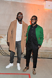 Left to right, DUMI OBUROTA and TINIE TEMPAH at a dinner hosted by Jonathan Saunders, Fantastic Man & Selfridges to celebrate Jonathan Saunders AW13 Menswear collection and London Collections held at the Old Selfridges Hotel,  Orchard Street, London on 8th January 2013.