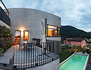 external of a modern house with pool, evening scene