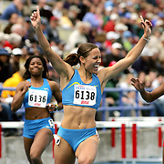 Local girl Lolo Jones defeated  a defending world championin the Drake Relays special 100 meter hurdles.  Jones went to high school at Roosevelt High School, just a mile from the Drake University campus.  photo by david peterson